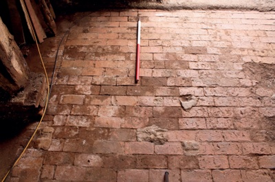 Original Brick Threshing Floor In A Historic Barn