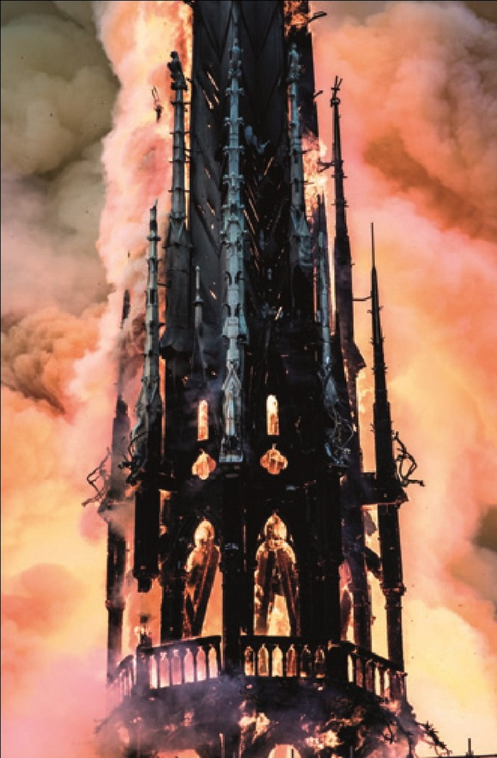 Notre Dame's spire engulfed by fire