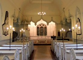 view of the church interior with its pale blue and white colour scheme pendant ogee