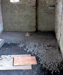 A Limecrete Slab Being Laid Over Geotextile Separation Layer With Clay Aggregate Below The Result Is Solid Floor That Breathes Across Its Entire